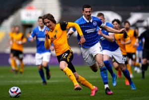 Lewis Dunk brings down Wolves' Fabio Silva as the forward raced clear on goal.