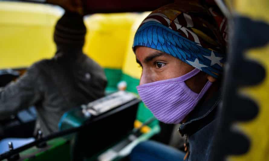 An auto rickshaw passenger in Delhi.