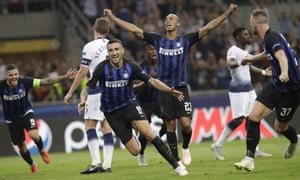Internazionale's Matias Vecino, centre, starts the celebrations after scoring the late winner against Tottenham at San Siro.