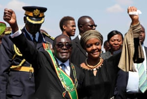 2014: Robert and Grace Mugabe greet supporters at a national Heroes Day rally in Harare on 11 August. Mugabe named his 49-year-old wife as head of the ruling Zanu-PF party's women's wing.