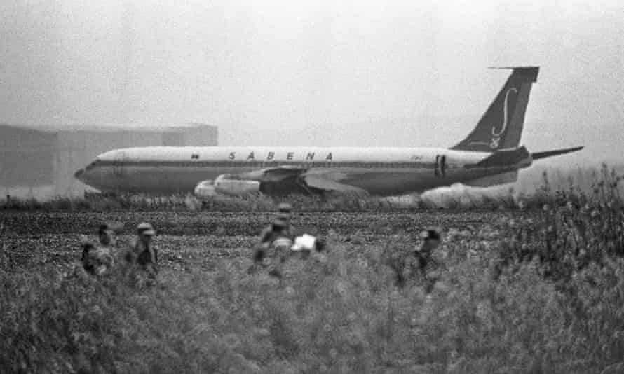 Israeli troops patrol around the plane.