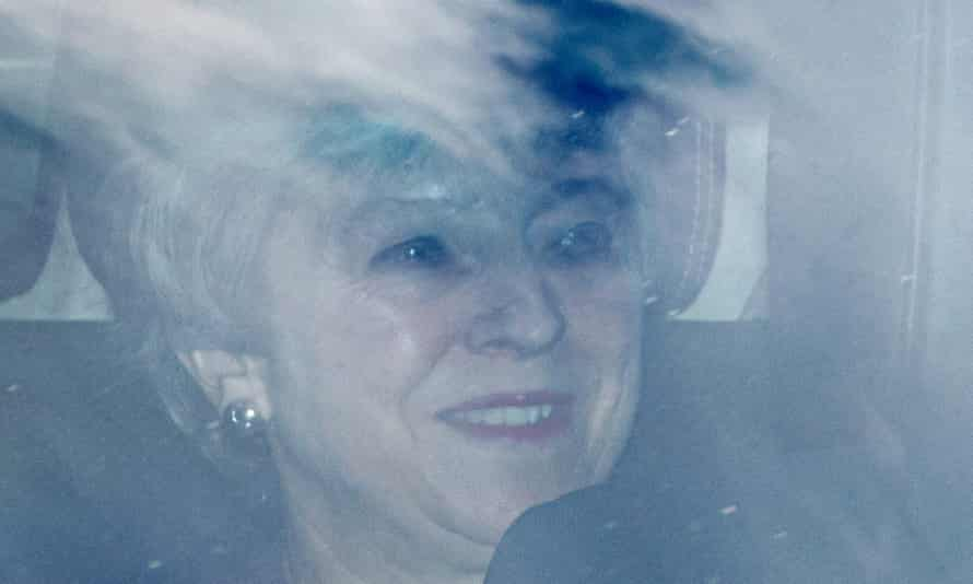 Theresa May smiles as she leaves parliament on Thursday.