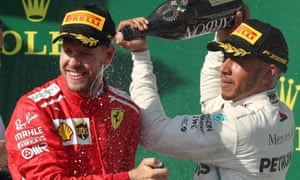Lewis Hamilton (right) and Sebastian Vettel on the podium after Hamilton's victory in Hungary in late July in the last Formula One race before the summer break.