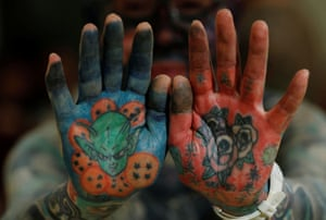 Author Hiroki Takamura has tattoos covering his palms. 'In the 2000s, tattoo magazines began to increase and even women began to get more tattoos. I thought there was hope that tattoos would finally be accepted the way they are in Europe.'