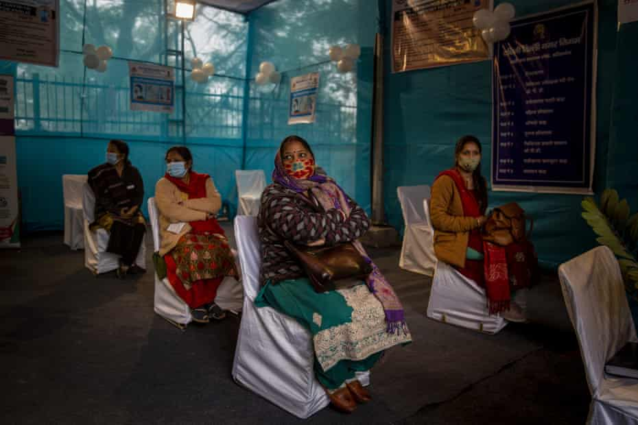 People await for their turn during a trial at a Covid vaccination centre in New Delhi, India