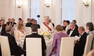 Queen Elizabeth II speaks during a state banquet in her honour in Berlin.
