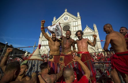 The red team of Santa Maria Novella celebrate after winning their semi-final at Piazza Santa Croce.