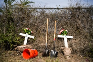 Headstones that marked unidentified migrant graves moved aside while Texas State University graduate students exhume bodies at La Grulla cemetery on December 17, 2019.