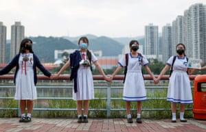 Hong Kong, China: Anti-government protesters form a human chain in Hong Kong