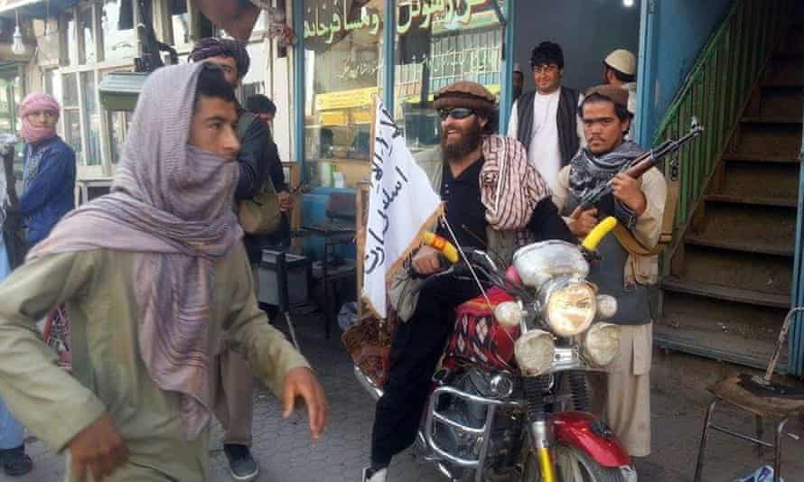 A Taliban fighter sitting on a motorcycle in Kunduz on Tuesday