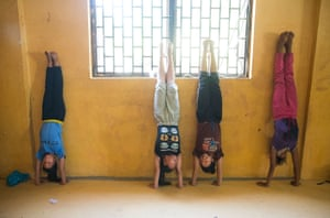 Students do handstands as they warm up before a practice session