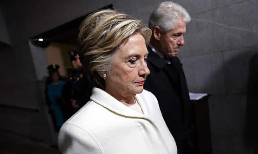 Hillary and Bill Clinton at Donald Trump's inauguration in January. The memoir has already reopened old wounds among Democrats who insist it is time to look forward, not back.