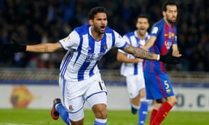 Real Sociedad's Willian José celebrates scoring against Barcelona.