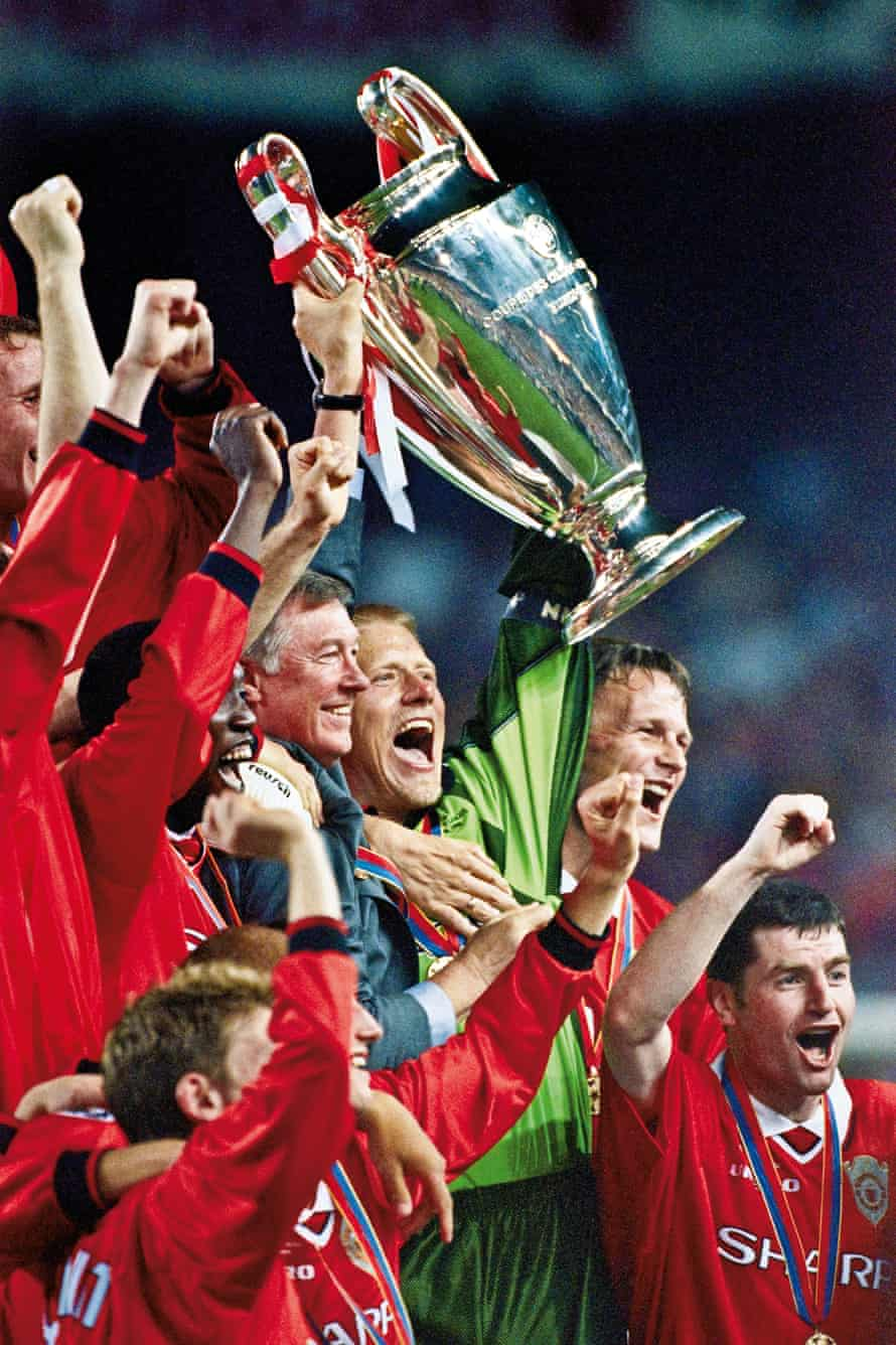 The Champions League trophy is raised aloft by Ferguson and goalkeeper Peter Schmeichel after Manchester United's victory over Bayern Munich in the final in 1999