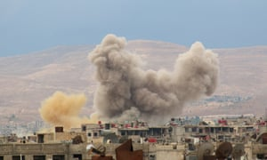 Smoke rises from the Darayya suburb of eastern Damascus in October last year.