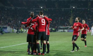 Henrikh Mkhitaryan is congratulated by his team mates after his goal