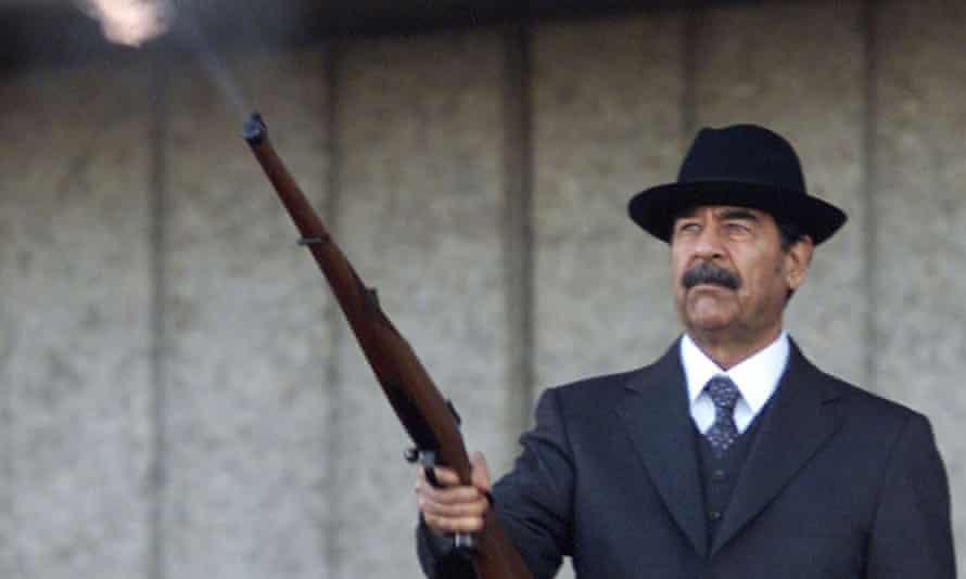 Former Iraqi president Saddam firing shots into the air in 2000.