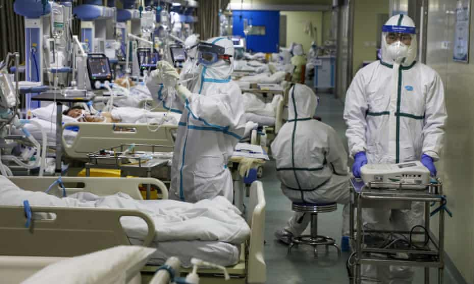 Medical workers treating patients in the isolated intensive care unit at a hospital in Wuhan, Hubei province.