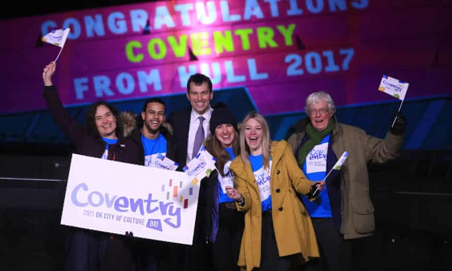 Arts minister John Glen, third left, with members of the winning Coventry bid team.