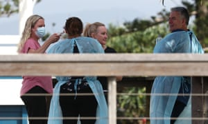 Medical staff have their temparature checked outside the Byron Surfclub in Byron Bay, NSW.