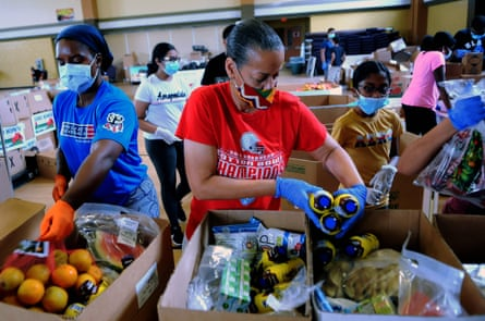 Volunteers prepare boxes of food from the Second Harvest Food Bank of Central Florida in July 2020.