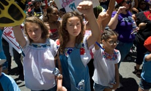 Young people join a protest against Donald Trump's immigration policy outside the federal courthouse in San Diego, where lawyers meet clients in the basement.