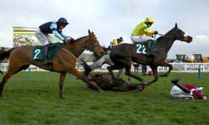 Indefatigable ridden by jockey Rex Dingle (left) runs past Column of Fire and fallen jockey E Walsh during the Martin Pipe Conditional Jockeys Handicap Hurdle.