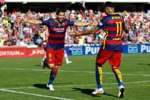 Luis Suarez celebrates his hat-trick with Neymar.