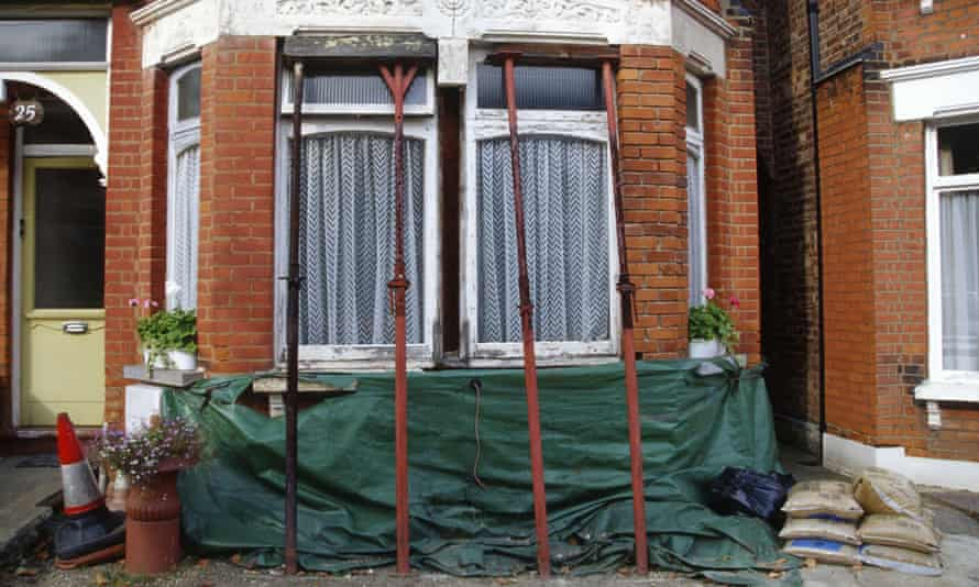 Palmer's Green north London Edwardian terrace house brick bay being held up by props due to subsidence