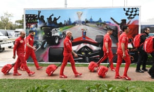 Members of the Ferrari team arrive to pack up their equipment after the Formula One Australian Grand Prix was cancelled in Melbourne.