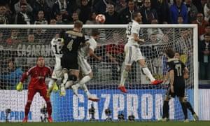 Ajax's Matthijs de Ligt rises high for the winning goal against Juventus.
