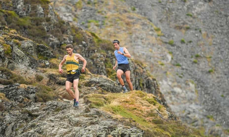 Kílian Jornet, en route to smashing the Bob Graham Round, is led by Carl Bell of Keswick AC