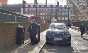 An electric car charging point blocks a pavement in London.