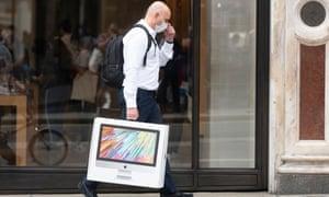 A shopper leaves the Apple store in Regent St, London