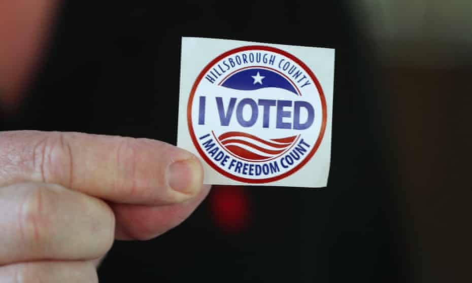 A voter shows off his 'I Voted' sticker after casting an early ballot on 22 October in Tampa, Florida.