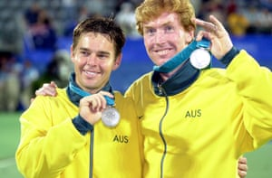 Tennis doubles partners Mark Woodforde and Todd Woodbridge display their Olympic silver medals after being defeated by Canadians Sebastien Lareau and Daniel Nestor.