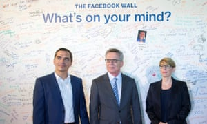 Germany's interior minister Thomas de Maiziere, center, met with Facebook's Martin Ott and Eva-Maria Kirschsieper at the Berlin headquarters on Monday.