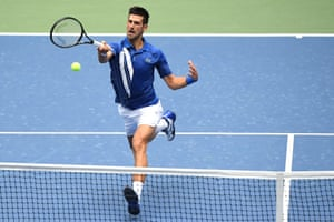 Novak Djokovic hits a forehand against Kyle Edmund.
