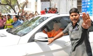 Uttar Pradesh chief minister Yogi Adityanath on his way to visit the alleged victim.