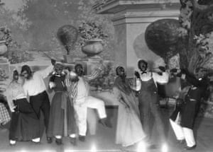 A theater group performs in black face, c. 1910.
