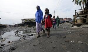 Children walk in Lagos, Nigeria