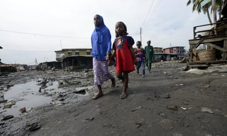 Children walk in Lagos, Nigeria