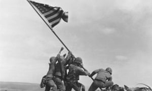 US marines raise the American flag atop Mount Suribachi on the island of Iwo Jima. Amateur history buffs have called into question the identity of one of the flag-raisers.