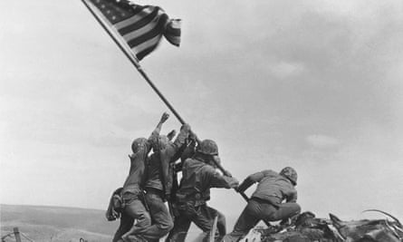 US Marines raise the American flag atop Mt Suribachi, Iwo Jima, Japan, on 23 February 1945.