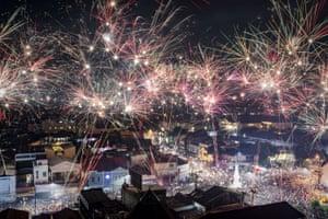 Fireworks illuminate the city's skyline during New Year's Eve celebrations of 2017 on on January 1, 2018 in Yogyakarta, Indonesia