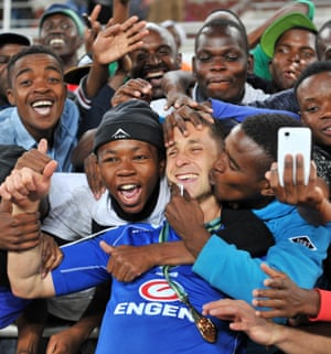 Dean Furman is mobbed by fans as they celebrate SuperSport United winning the 2016 Nedbank Cup final