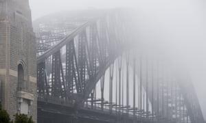 The Sydney Harbour Bridge shrouded in fog