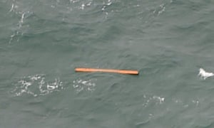 A view from an Indonesian search and rescue aircraft over the Java Sea of debris that may come from the missing AirAsia flight.
