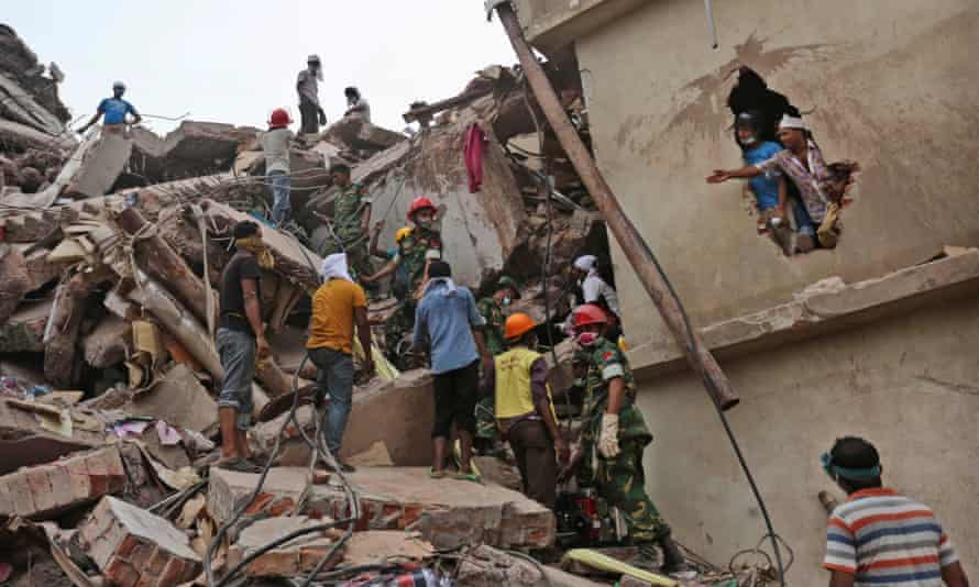 Rescue workers search for survivors after the collapse of the Rana Plaza factory complex.