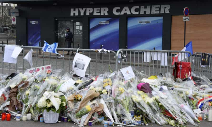 Flowers left in tribute to the victims of the attack at the Hyper Cacher supermarket in Paris in 2015